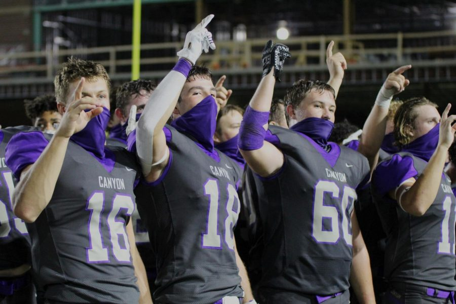 Seniors Jay Defoor, Jack McKay and Sam Williams participate in the school song at the varsity football game against Lubbock Estacado, Friday, September 11th. Defoor said the renovations brought new energy to the field and the stadium.
