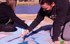 The Texas Art Education Association's Art in the Park chalk competition attracted 50 Canyon students competing as individuals, duos and trios on Saturday, Oct. 17. Taking home the People's Choice Award and a $100 cash prize for their work; duo team, sophomores Raylee Fernandez and Taryn Gullick, paint their abstract, award winning entry.