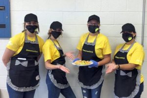 Seniors Kandenze Mowry and Kodi Hicks, sophomore Berdena De Groot and junior Jacie Guerrero show off their dish after the judging portion of the Food Challenge competition. They placed first and will advance to State in June of 2021.