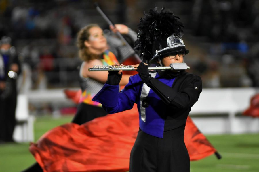 """The Soaring Pride Band's show, 'Fugue State,' is under the direction of Eric Rath. This is his first year as head director of the Soaring Pride Band. Prior to this, Rath worked as head director for Canyon Junior High. """"I came in 2014,"""" Rath said. """"So coming into this role has different responsibilities, but it's not a complete change of pace. It was really important to try to keep those standards high, and keep the culture of excellence in place."""""""