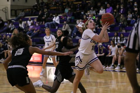 Senior Kyla Cobb goes for a layup at a game against the Lady Raiders in November. The team won the game 58-31 and now has an overall season record of 25-1 at a .96% win rate. Currently in playoffs, the team will play against Levelland Wednesday, Feb. 24 at 6 p.m. Cobb said she would describe her season with the word
