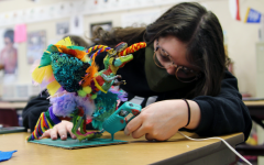 Senior Elizebeth Daeley works on her project for Wayland Baptist University's Language and Culture Festival in AP Spanish IV. Students have the option to perform skits, poetry reading, extemporaneous speaking, dance, music, art and songs. Daeley created an alebrije, a mythical spirit guide in Hispanic cultures.