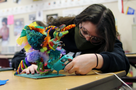 "Senior Elizebeth Daeley works on her project for Wayland Baptist University's Language and Culture Festival in AP Spanish IV. Students have the option to perform skits, poetry reading, extemporaneous speaking, dance, music, art and songs. Daeley created an alebrije, a mythical spirit guide in Hispanic cultures. ""I didn"