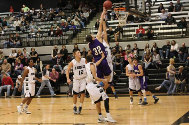 Sophomore Aaron Hughes gets air in Tuesday night's game against the Randall Raiders. Canyon defeated Randall 53-51.