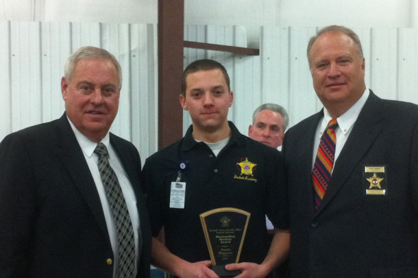 Senior and Outstanding Student award winner Austin Musgrave with Sheriff Joel Richardson and Chief Deputy Dave Thurman.