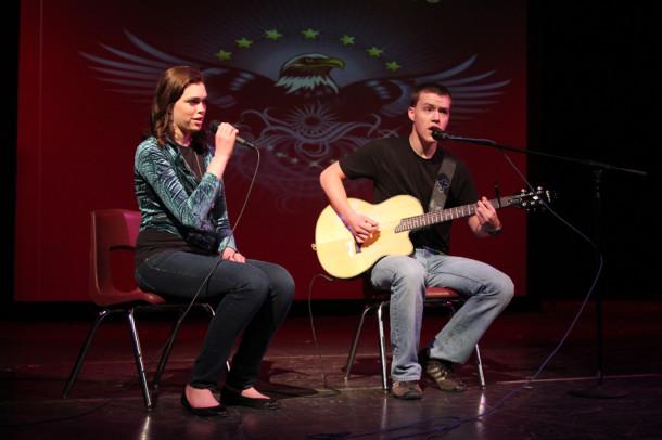 Senior Rachel Smith and junior Christian Farren sing