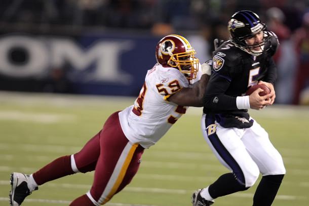 Baltimore Ravens quarterback Joe Flaco (5) is tackled by Washington Redskins London Fletcher (59) during their game played at M&T Bank Stadium in Baltimore, Maryland, Sunday, December 7, 2008. (George Bridges/MCT)