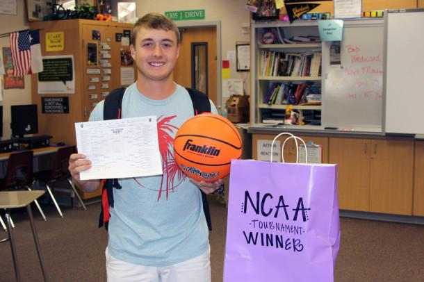 Senior Travis McMorrough won the The Eagle's Tale March Madness Challenge, which scored him a new basketball and a bag of sports snacks.