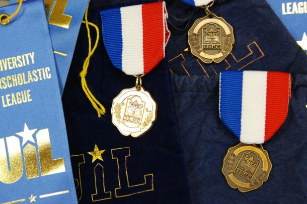 A few of the medals and ribbons awarded in Austin by ILPC to Canyon High journalism students