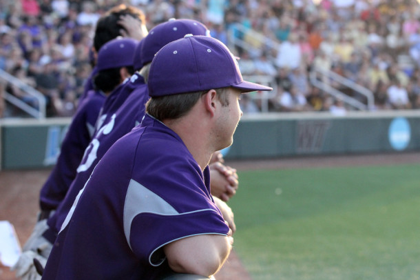 Senior Travis McMorrough and the team watch the game as the packed stands cheer on Canyon.