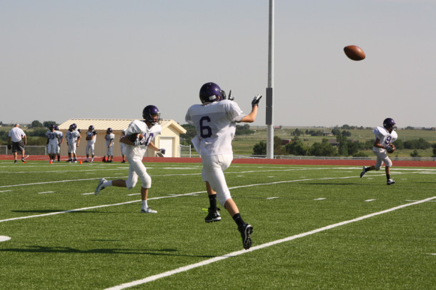 The Canyon Eagles run a receiving drill at an afternoon practice last Wednesday.