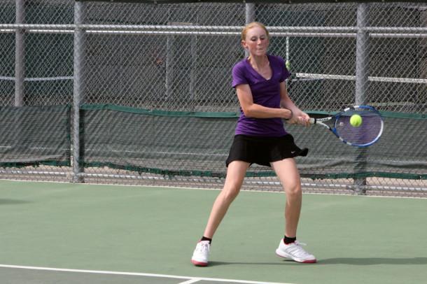 Freshman Brailey McMinn returns the ball while winning her match against Dumas.