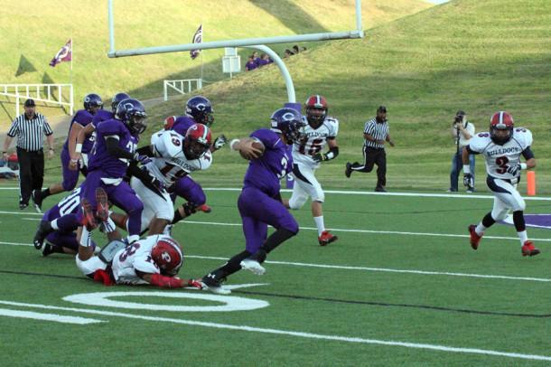 Senior quarterback Blake Weaver breaks a Bulldog tackle to score for Canyon.