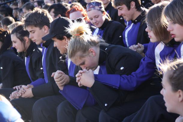 Band members wait in anticipation for the results of the High Plains marching contest to be announced on Oct. 5.