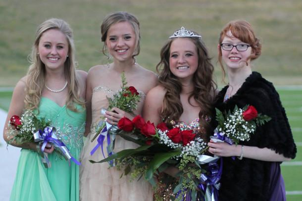 Morgan Finke, Lorin Barnes, Annalisa Delao and Rebekah Crump huddle together after the chilly-weather crowning of Homecoming queen.