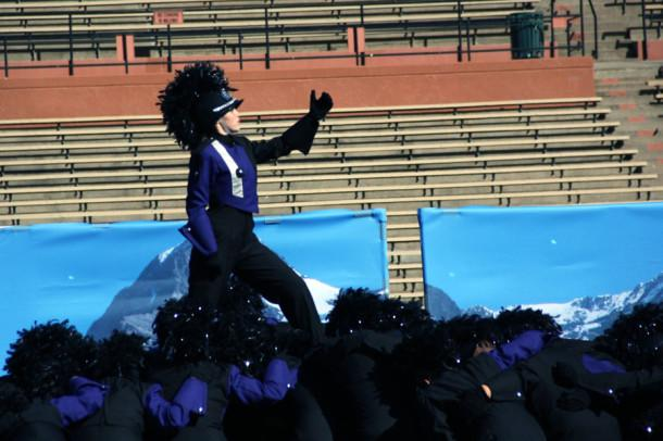 Freshman Madison Edwards concludes the band performance at the High Plains Marching Festival by creating an illusion of climbing a mountain.