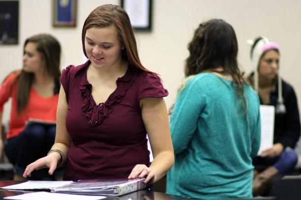Senior Georgia Hansen rehearses her music during choir. Hansen placed 9th chair in Alto 2 in All-Region Nov. 2.
