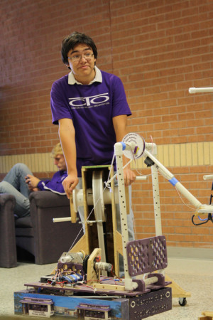 Andrew Walsh operates robot at practice course during Electives Fair.