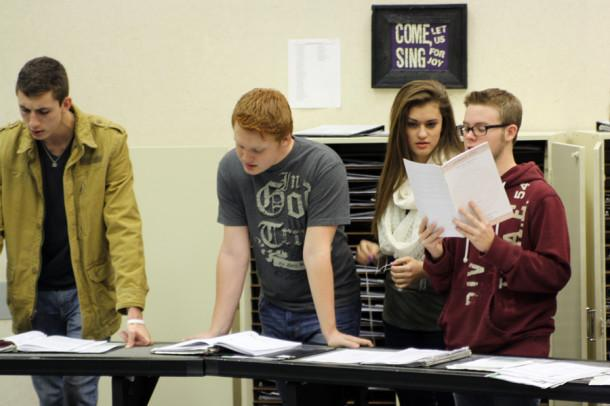 Junior Aaron Hughes, senior Colton Eder, junior Abby Franks and senior Shane Price practice All-State music in the CHS choir room during activity period.