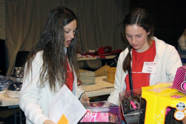 Juniors Madison Myrick and Macy Wright pack a gift box for a five-year-old girl at City Church Dec. 11 with Teen Leadership Amarillo & Canyon.