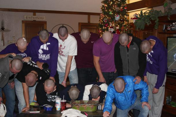 """The varsity boys basketball team formed a """"Canyon C"""" with their new haircuts in honor of Coach Crenshaw."""