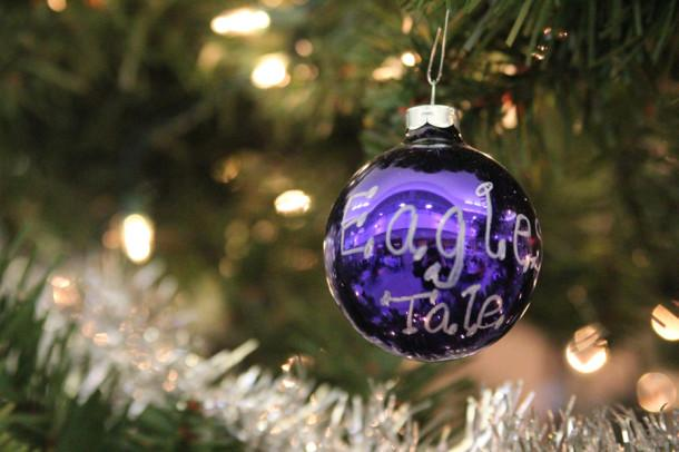 A purple ornament sporting The Eagle's Tale sparkles on the Christmas tree in the lower commons.