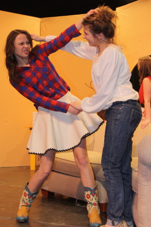 Junior Jade Burdick plays character Honey Raye Futrelle as she fights with Blakelee Brownd who portrays her sister, Rhonda Lynn Futrelle.