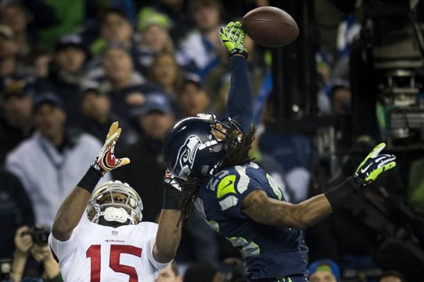 Seattle Seahawks cornerback Richard Sherman hits the ball away from San Francisco 49ers wide receiver Michael Crabtree and is intercepted by Seattle Seahawks outside linebacker Malcolm Smith on last play during the NFC championship game on Sunday, Jan. 19. The Seattle Seahawks defeated the San Francisco 49ers, 23-17.