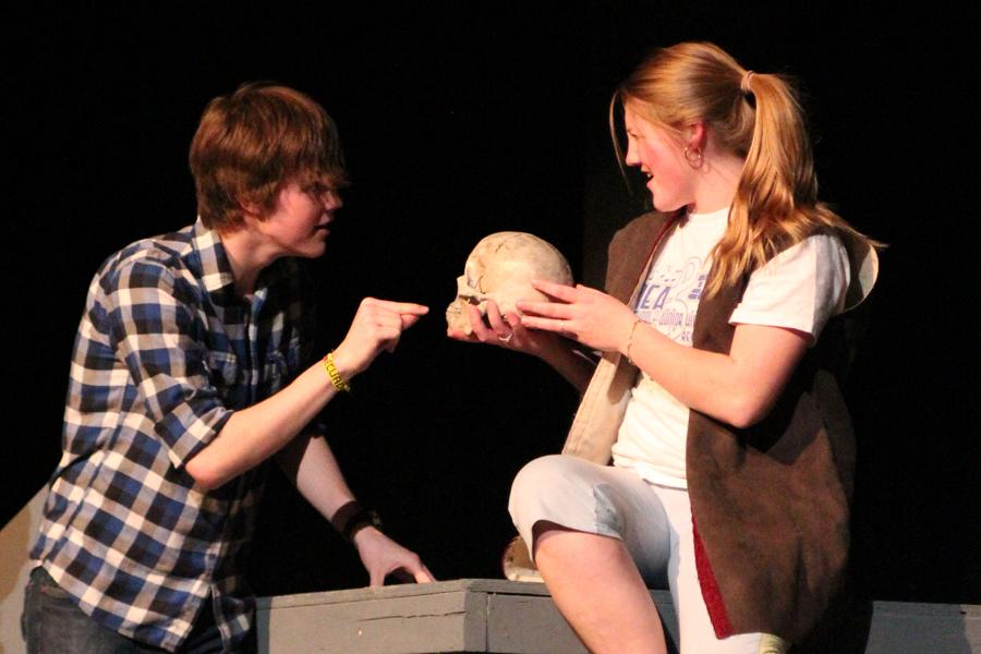 Senior Ryan Land and sophomore Kayla Finke interact on stage in a recent rehearsal of the one act play