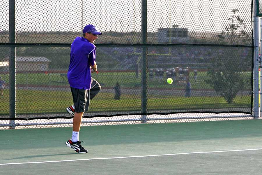 Senior Brighton McMinn hits a backhand in his singles match against Caprock last Tuesday. The Eagles finished second in district.