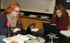 Seniors Keegan Fenton and Abby Franks use their Chromebooks in Biology. The science department received 250 Chromebooks this year.