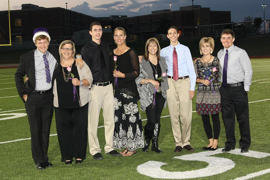 Homecoming+king+Ty+Crenshaw+and+his+mother%2C+Debbie+Crenshaw%3B+Aaron+Hughes+and+mother+Christie+Shippy%3B+Stacy+Glenn+with+son+Trevor+Glenn%3B+and+Karla+McCallie+with+son+Cade+McCallie+gather+after+the+announcement+during+the+powder+puff+game.