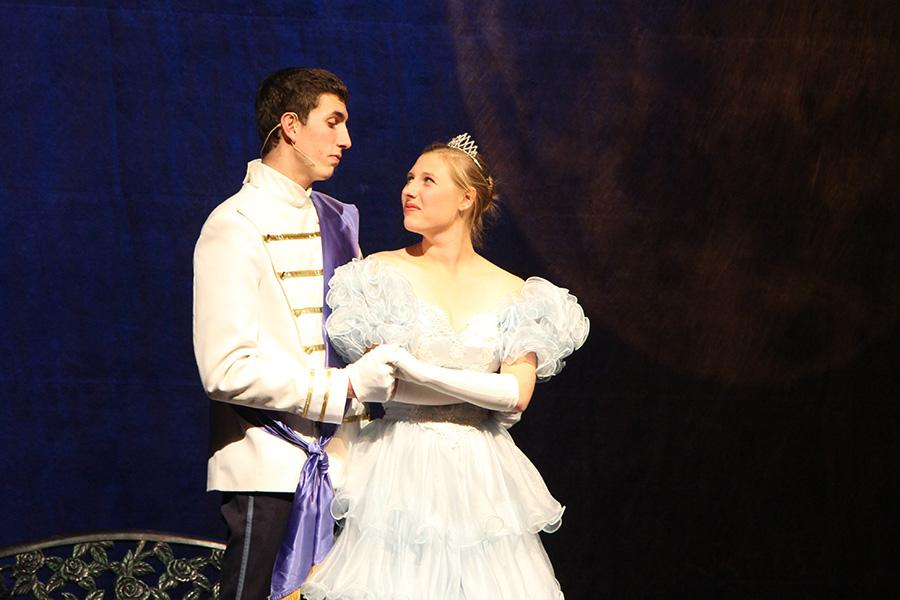 Prince Charming and Cinderella share a look during the ball.