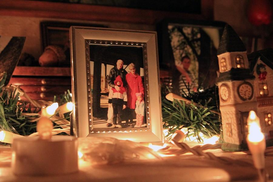 A photo of Abby with her brother and grandparents at Christmastime rests upon the mantle in her home.