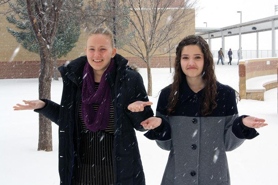 Eagle's Tale editor-in-chief Tasha Brown and associate editor Allison Koontz brave the snowy weather resulting from a complete disregard of a proper observance of Hoodie Hoo Day last Friday.