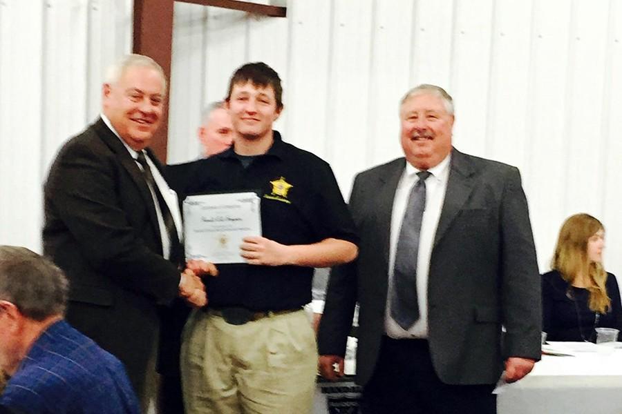 Senior Garrett Simpson graduates from the Sheriff's Academy.