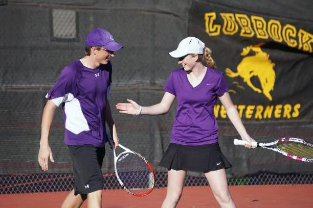 Senior Brighton McMinn and sophomore Brailey McMinn high five each other after winning their match against Tascosa.