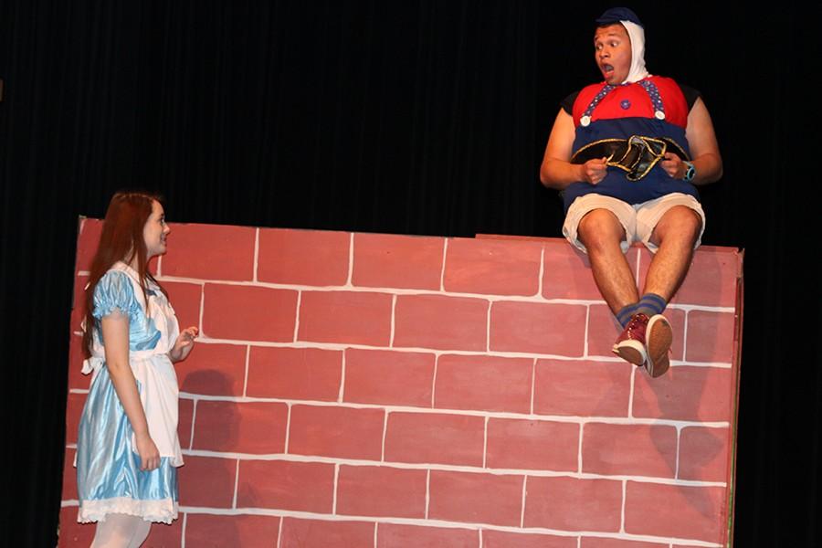 Sophomore Brooke Bellah as Alice talks to junior Ismael Granda, who plays Humpty Dumpty.