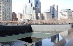The reflecting pools sit surrounded by New York streets and skyscrapers.