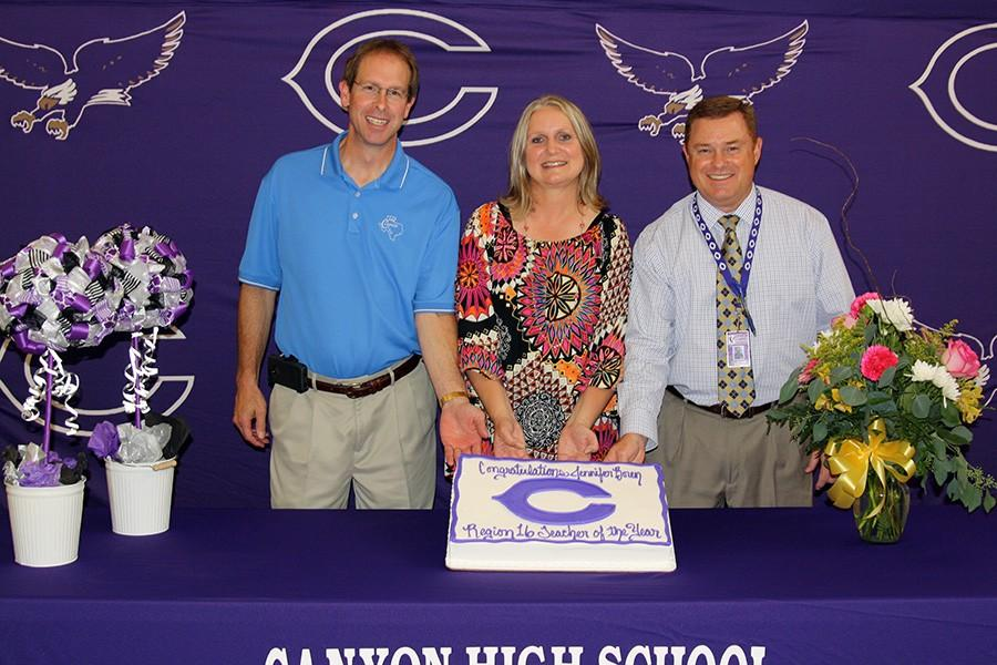 After being named Region 16 Secondary Teacher of the Year, RTI Math teacher Jennifer Boren celebrates with Superintendent Darryl Flusche and Principal Tim Gilliland at her reception.