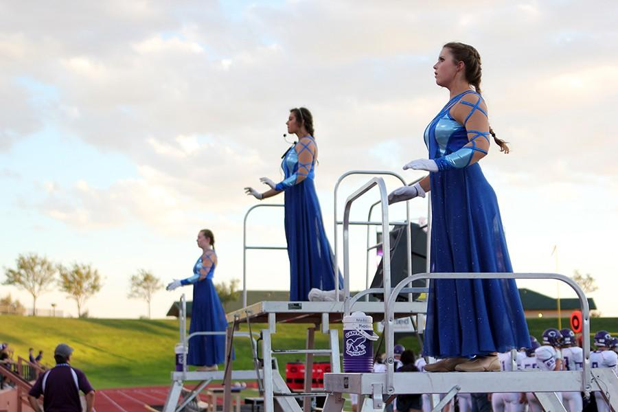 Drum Majors Maddy Edwards, Izzy Wheeler, and Berkley Trumbly conduct the band at the Tascosa game.