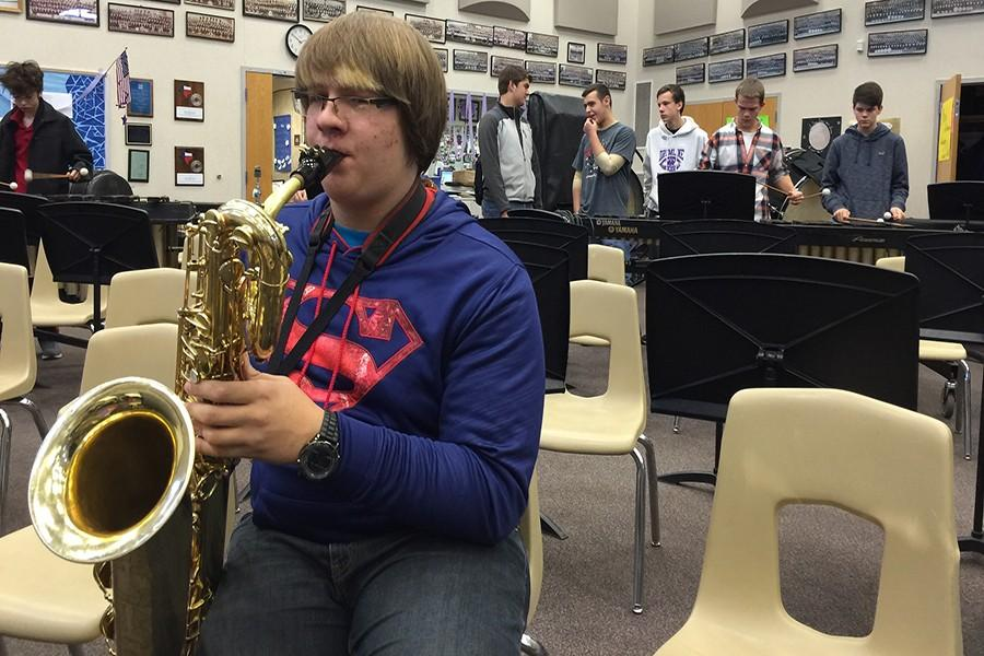 Nathan Armstrong practices his music for the UIL All Region Band Contest.