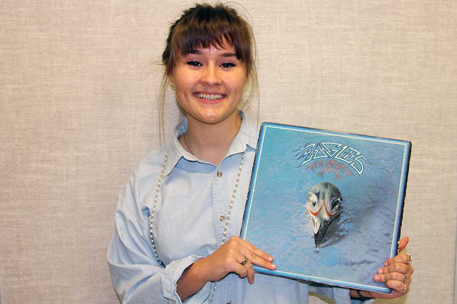 Senior Ryleigh Thompson holds the Eagle's vinyl album