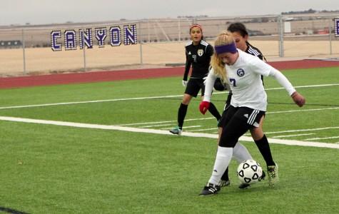 Junior varsity player Madisun Clark dribbles the ball during the Caprock game Feb 1.