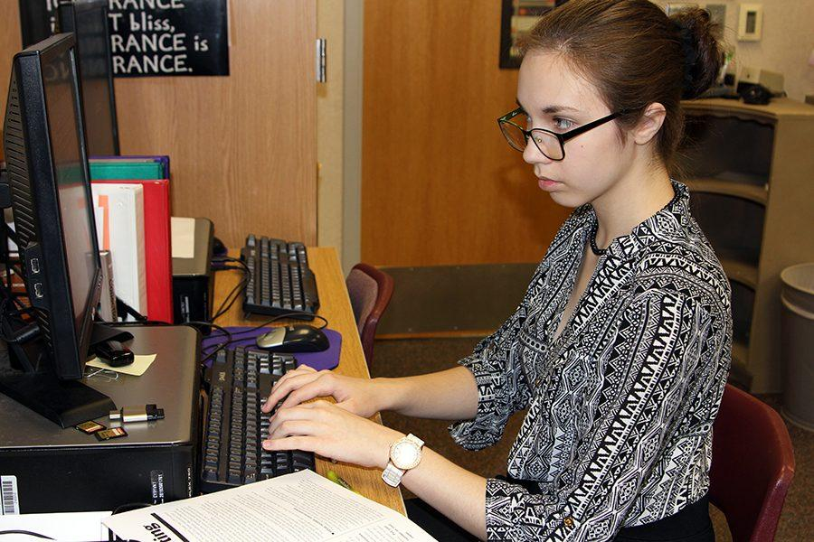 Freshman Erin Sheffield writes a News Writing practice prompt to prepare for the state contest.