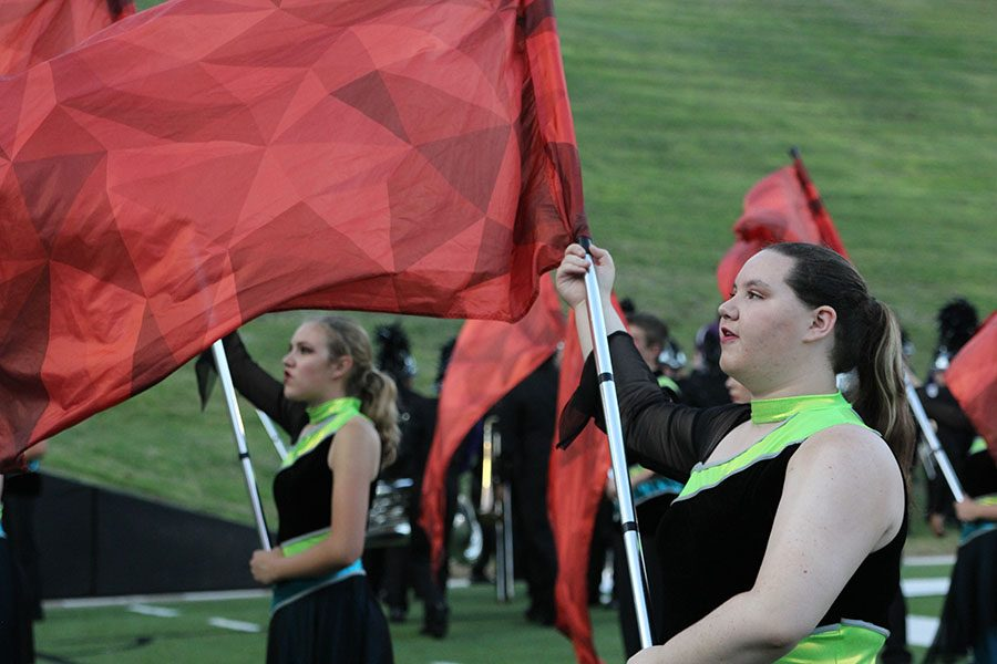 Colorguard captains Erica Perez and Rebecca Boehs warm up before halftime