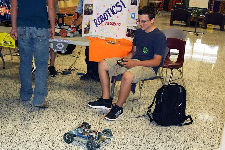 Sophomore Marshall Belcher demonstrates a robot during Club CHS.