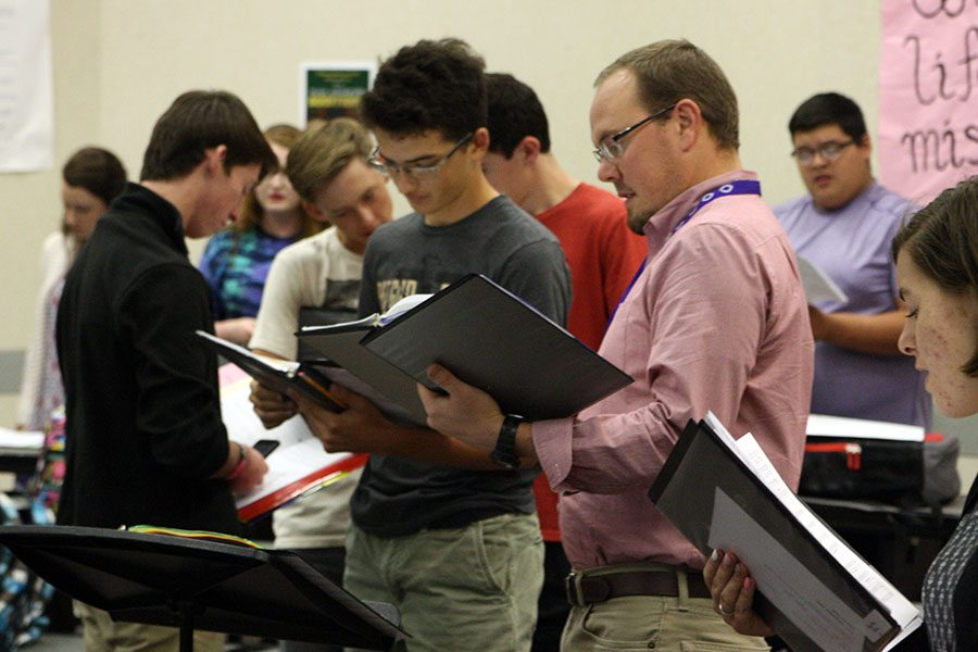 Choir director Brandon Farren works with the bass section on all-region music.