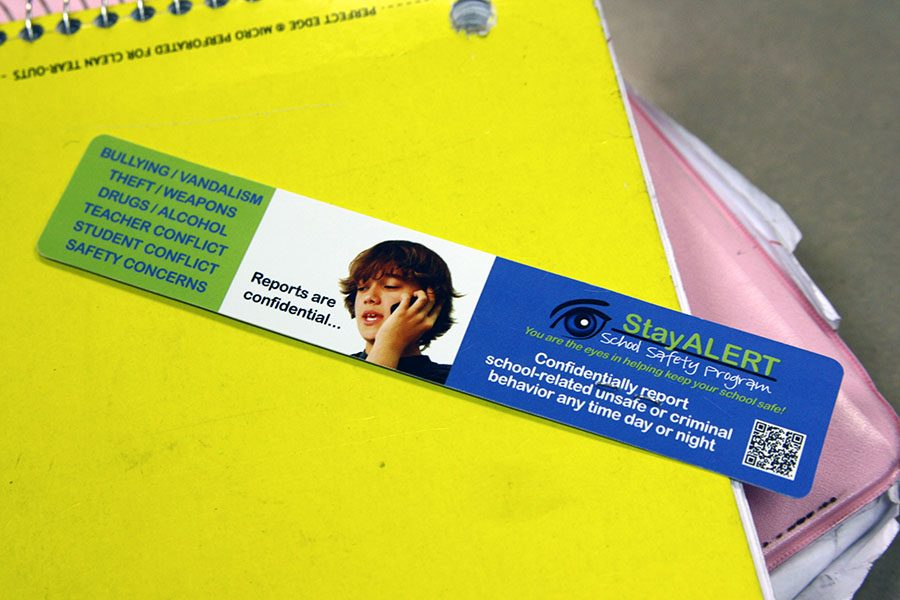Students receive Stay Alert bookmarks with contact information at class meetings at the beginning of the school year.