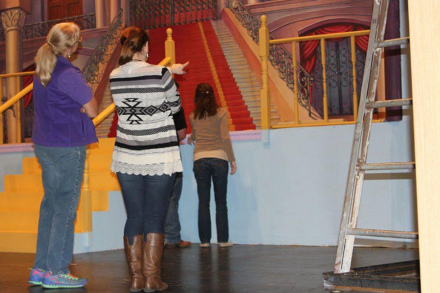 Art teacher Linda Podzemny and theater teacher Kylie Howell discuss set design of the all-school musical.
